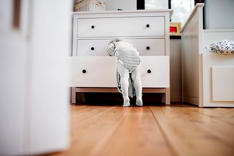 child looking in drawers