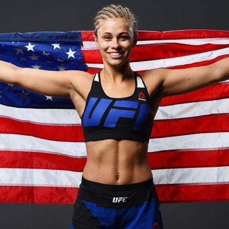 Paige VanZant posing with American flag