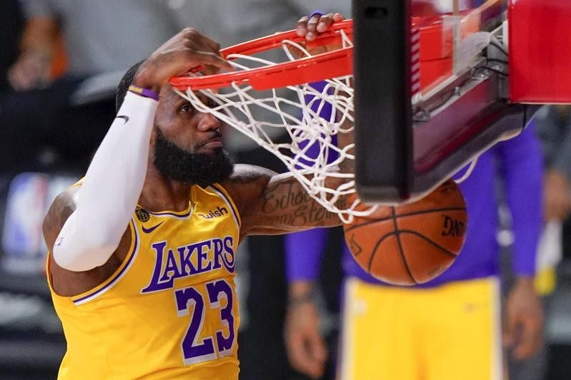 LeBron James of Los Angeles Lakers dunks against Miami Heat