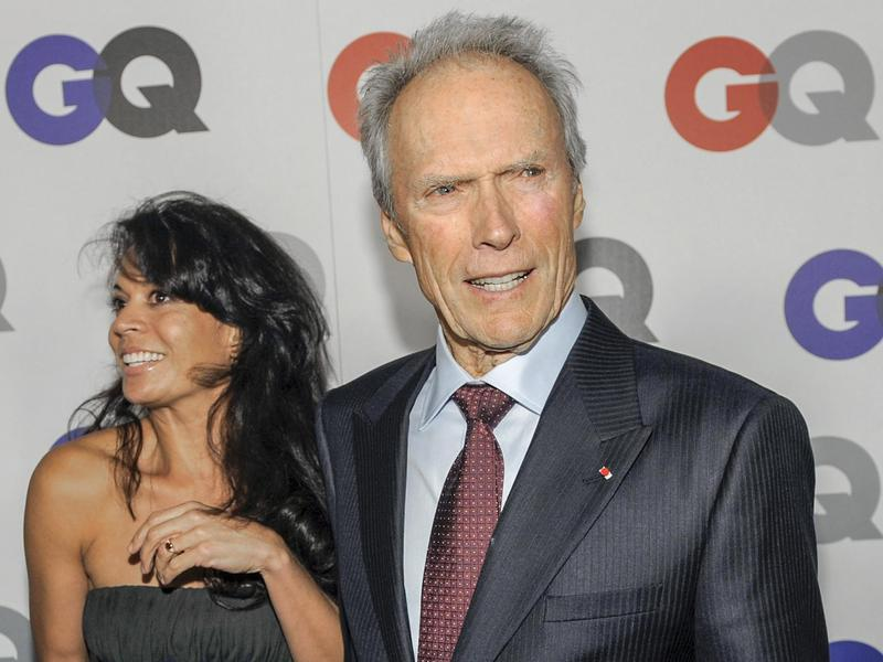 """Clint Eastwood arrives with his wife Dina at the 2009 GQ """"Men of the Year"""" party in Los Angeles."""