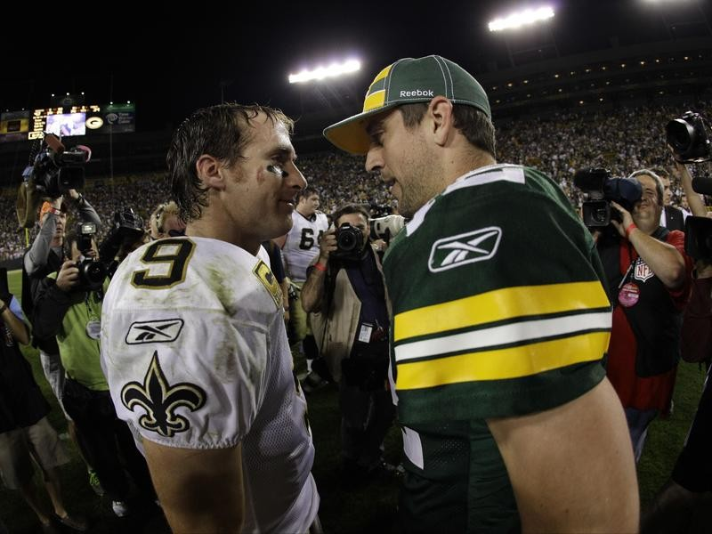 Drew Brees and Aaron Rodgers talk after a game