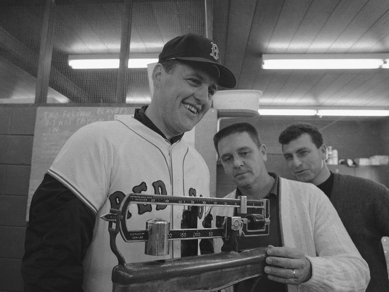 Dick Williams checks Gene Olivers weight