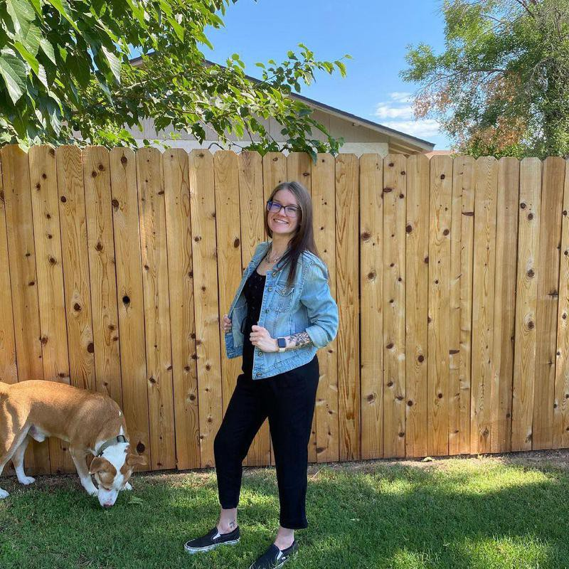 Dog photobombing backyard picture