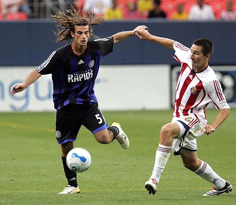 Kyle Beckerman fights for possession