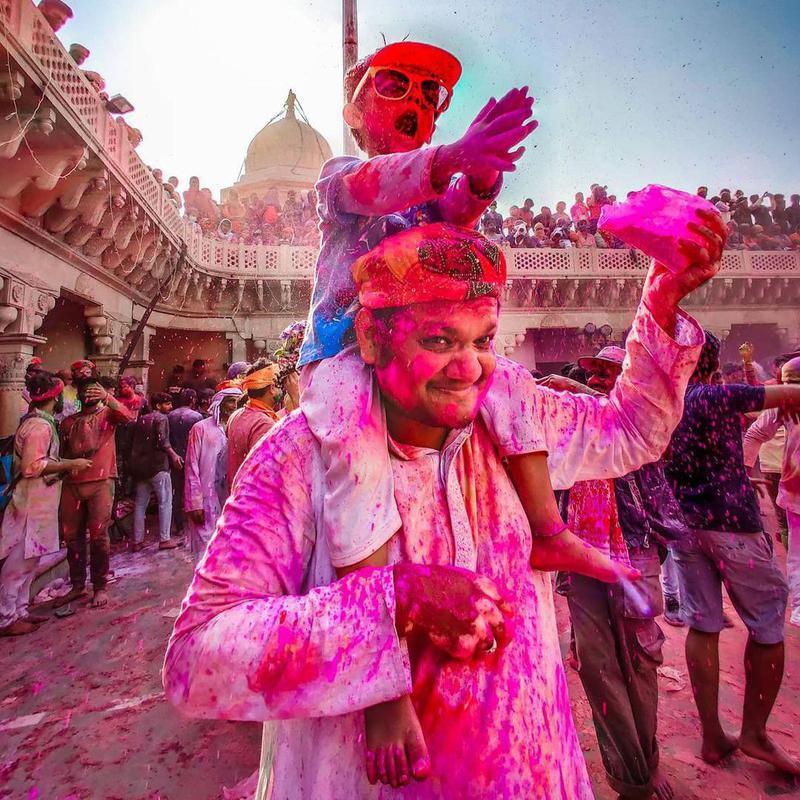 Father and son celebrating Holi