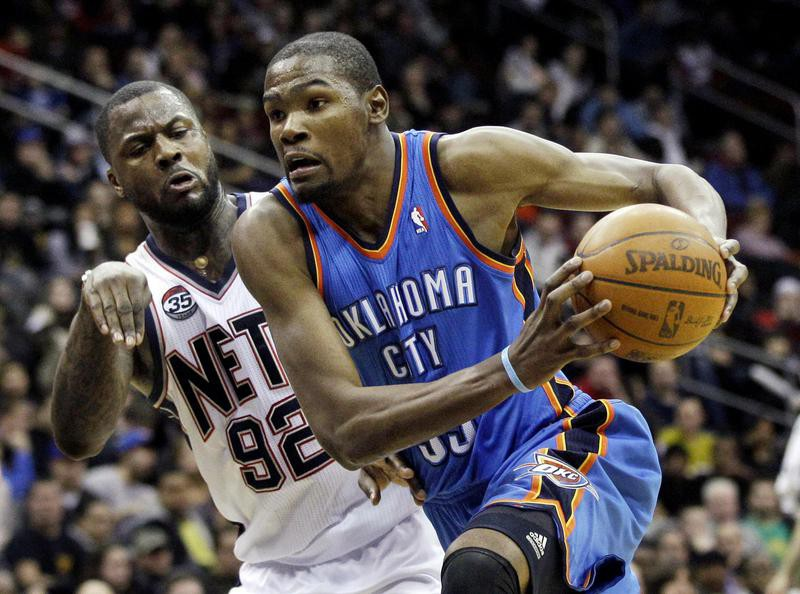 Kevin Durant drives to basket against New Jersey Nets
