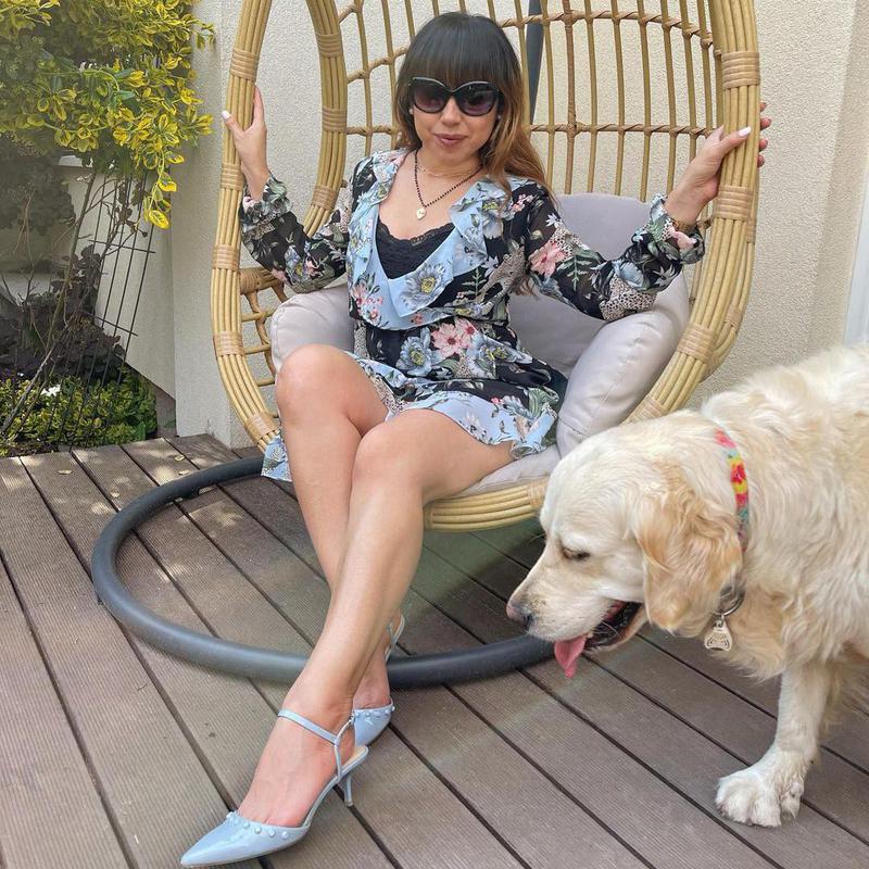 Dog photobombing a woman