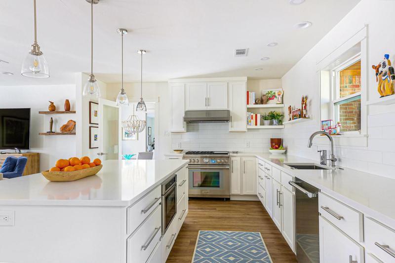 Large, minimalist white kitchen
