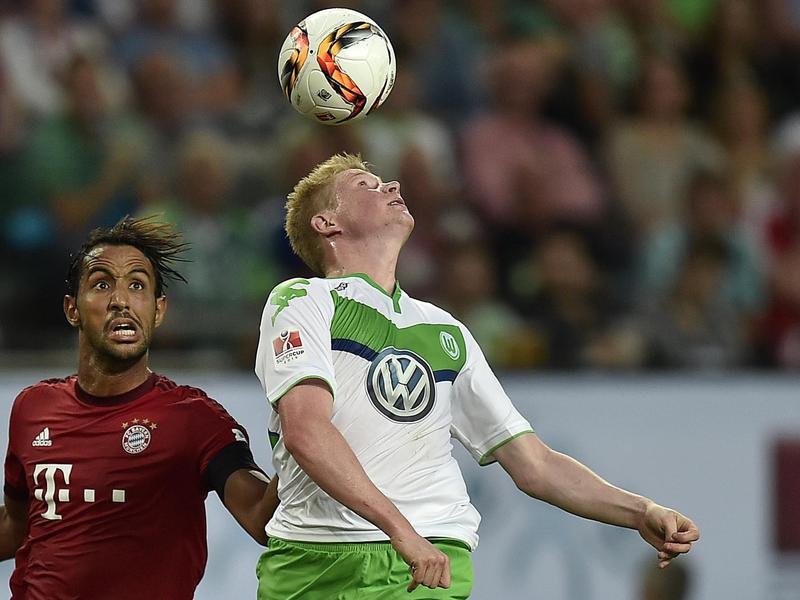 Kevin De Bruyne of Belgium (right) challenges for the ball during his time playing for VfL Wolfsburg in 2015.