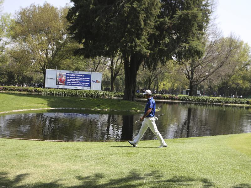 Hideki Matsuyama walks to the 7th green