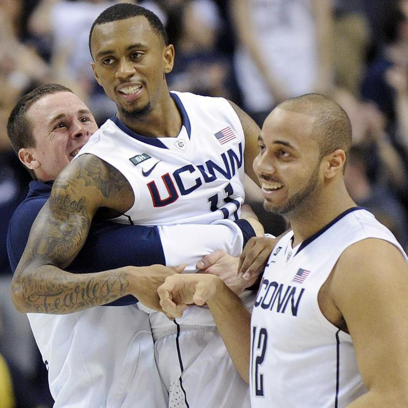 UConn Huskies celebrate after a win against Providence