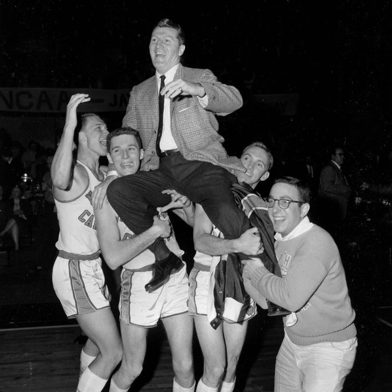 North Carolina players carry coach Frank McGuire