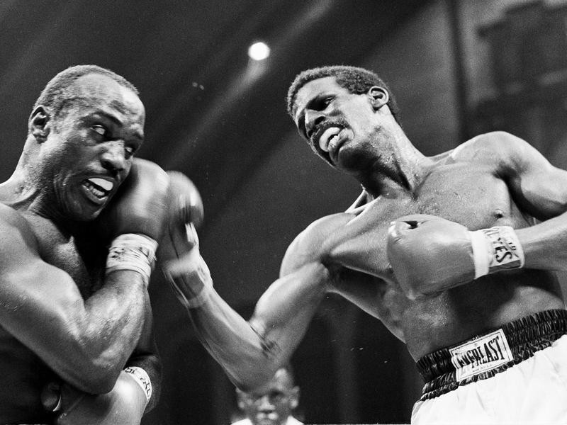 Dwight Muhammad Qawi and Michael Spinks in 1983