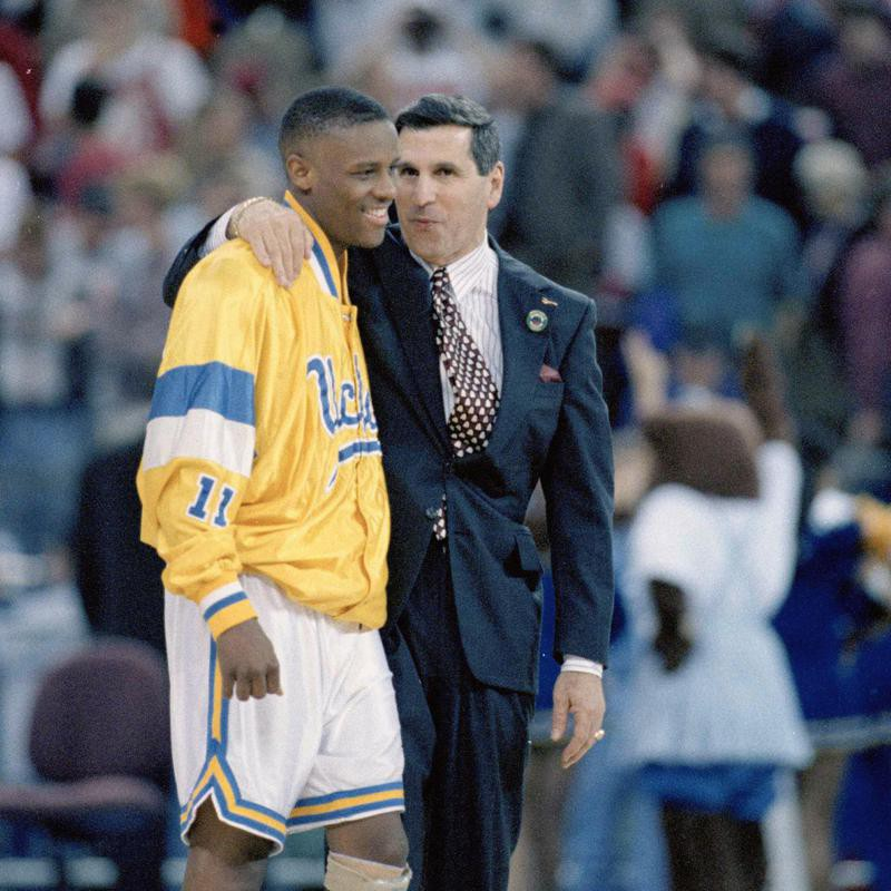 Tyus Edney celebrates with UCLA coach Jim Harrick