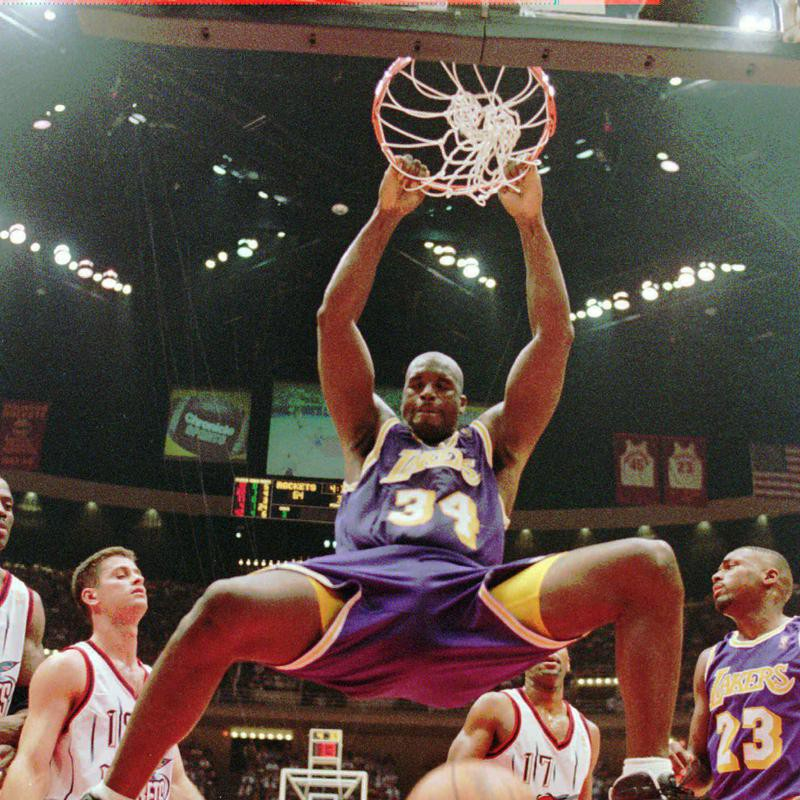 Los Angeles Lakers' Shaquille O'Neal hanging from the rim