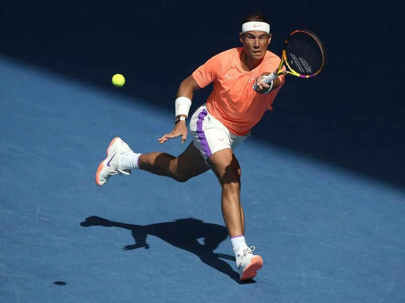 Spain's Rafael Nadal hits forehand return