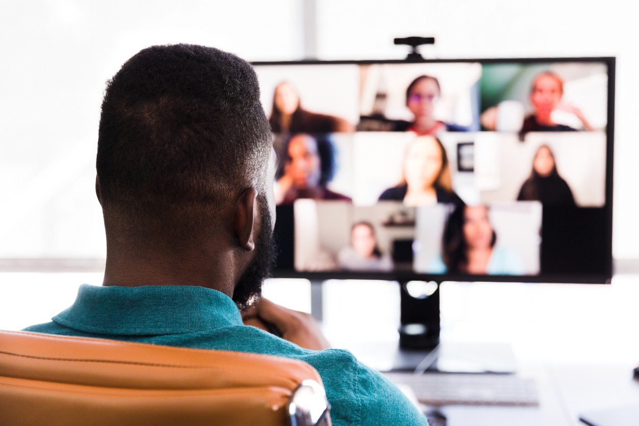 Business people participate in virtual meeting