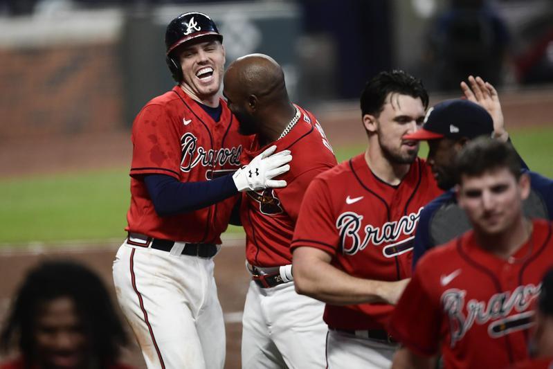 Freddie Freeman of Atlanta Braves celebrates two run home run