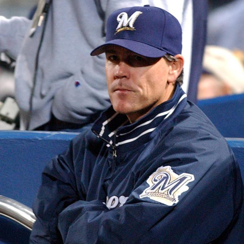 Ned Yost watches his team from the dugout