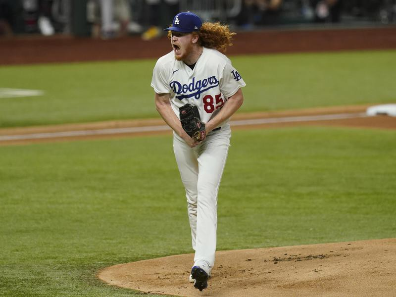 Los Angeles Dodgers starting pitcher Dustin May reacts