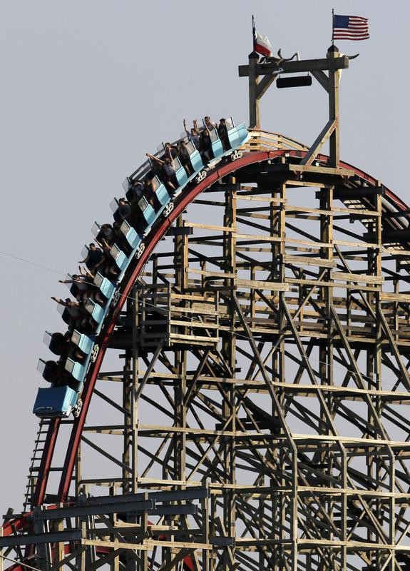 Texas Giant as they crest the top of the tallest drop o