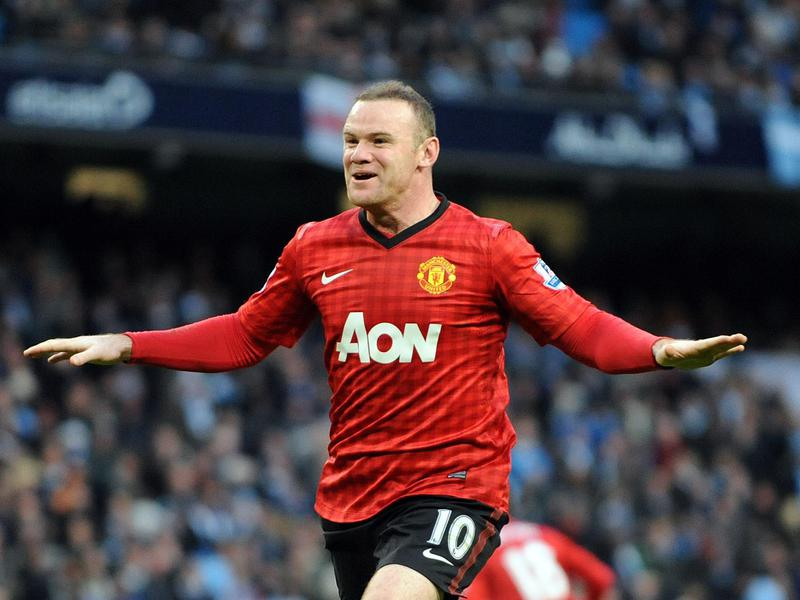 Wayne Rooney celebrates a victory against Manchester City during his time with Manchester United.