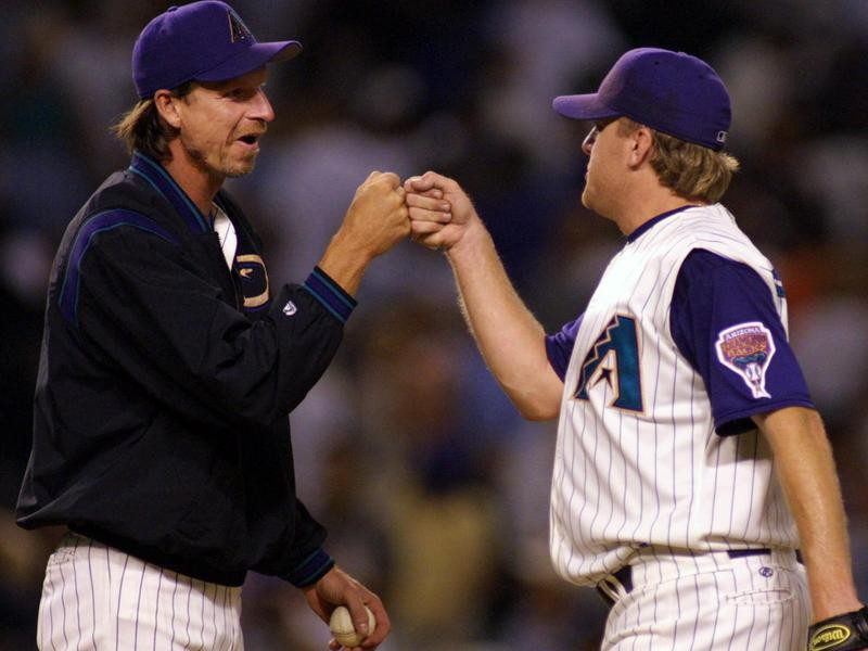 Curt Schilling receives fist bump from teammate Randy Johnson