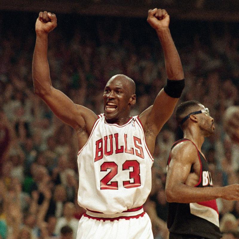 Michael Jordan celebrates the Bulls win