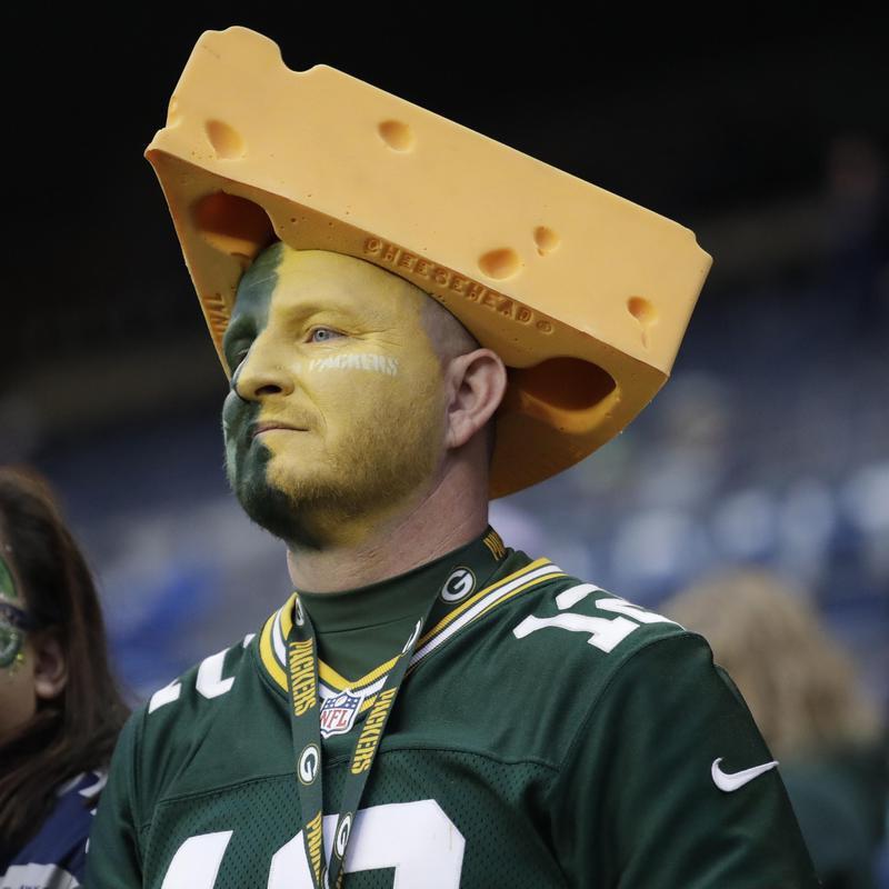 Green Bay Packers fan wearing a cheesehead hat