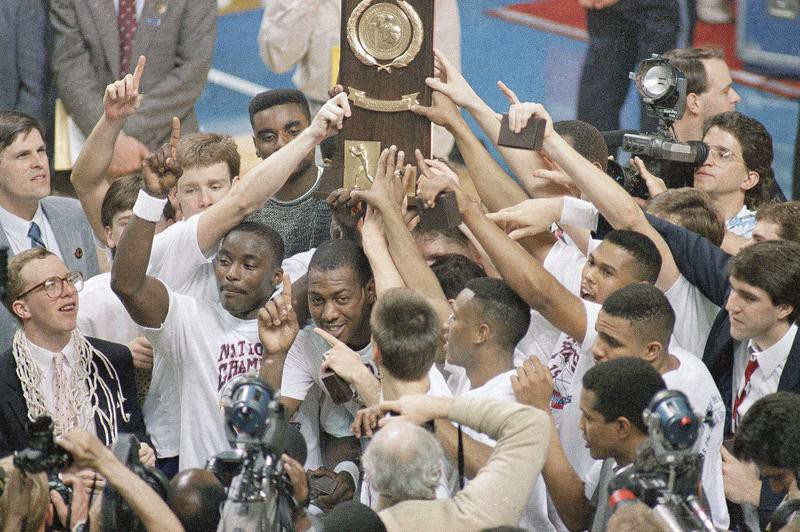 Kansas Jayhawks hold up trophy after winning NCAA title