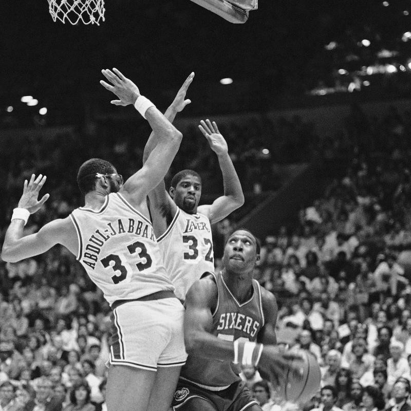 Kareem Abdul-Jabbar and Earvin Magic Johnson play defense