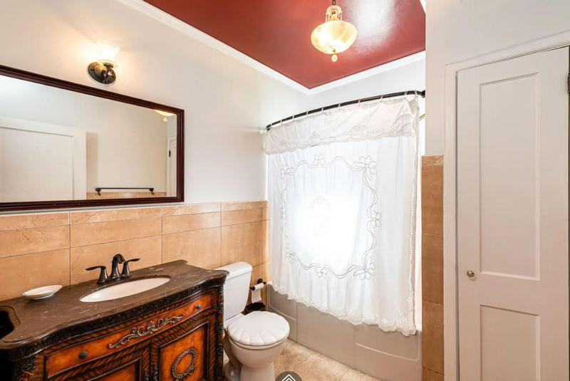 Bathroom with small shower and red ceiling