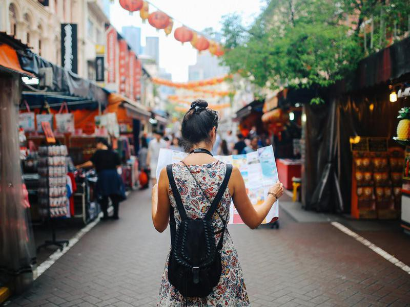young solo traveler woman in Singapore