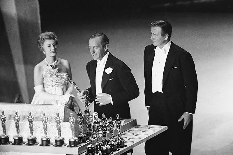 David Niven, Irene Dunn and John Wayne