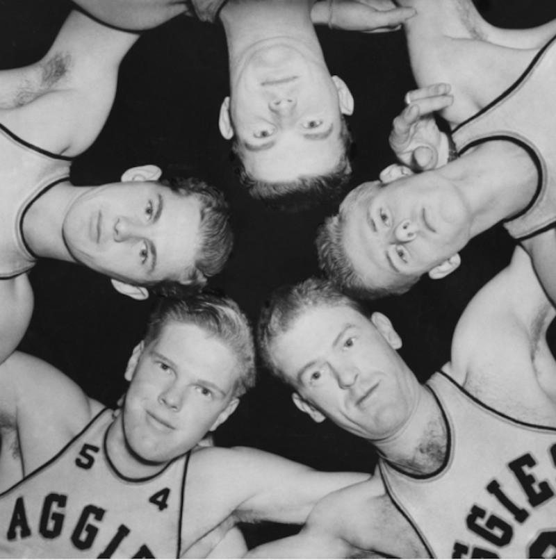 Oklahoma A&M Aggies posing in a circle