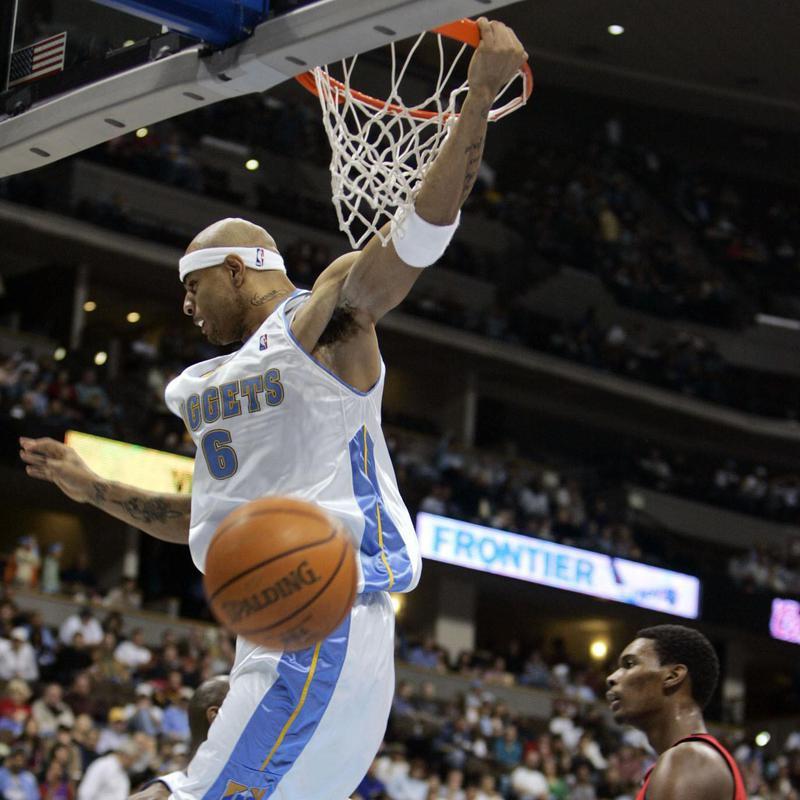 Kenyon Martin hangs on rim after dunking