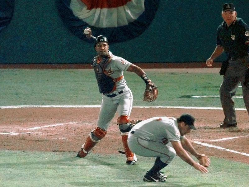 Sandy Alomar Jr. throws out Moises Alou of the Florida Marlins at the World Series
