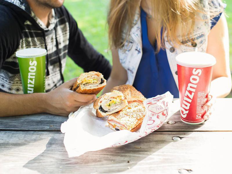 Couple eating Quiznos
