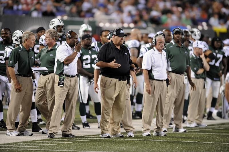 Rex Ryan on the sidelines with  New York Jets players and staff during game against New York Giants