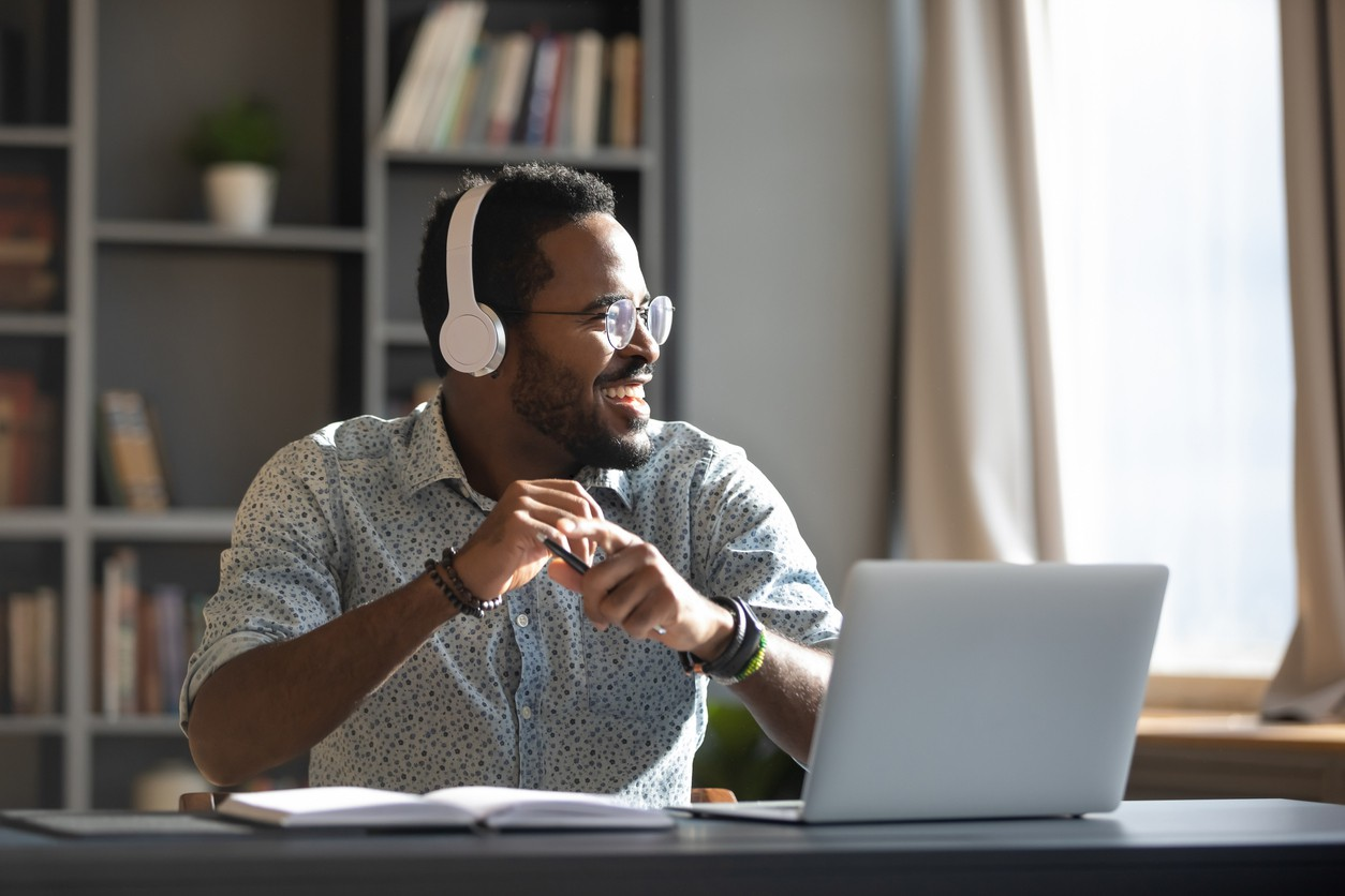 Guy smiling with headphones