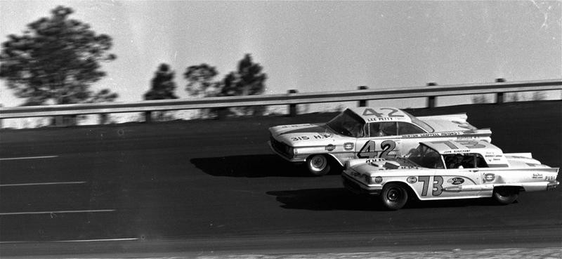 Lee Petty drives against Johnny Beauchamp over Daytona International Speedway