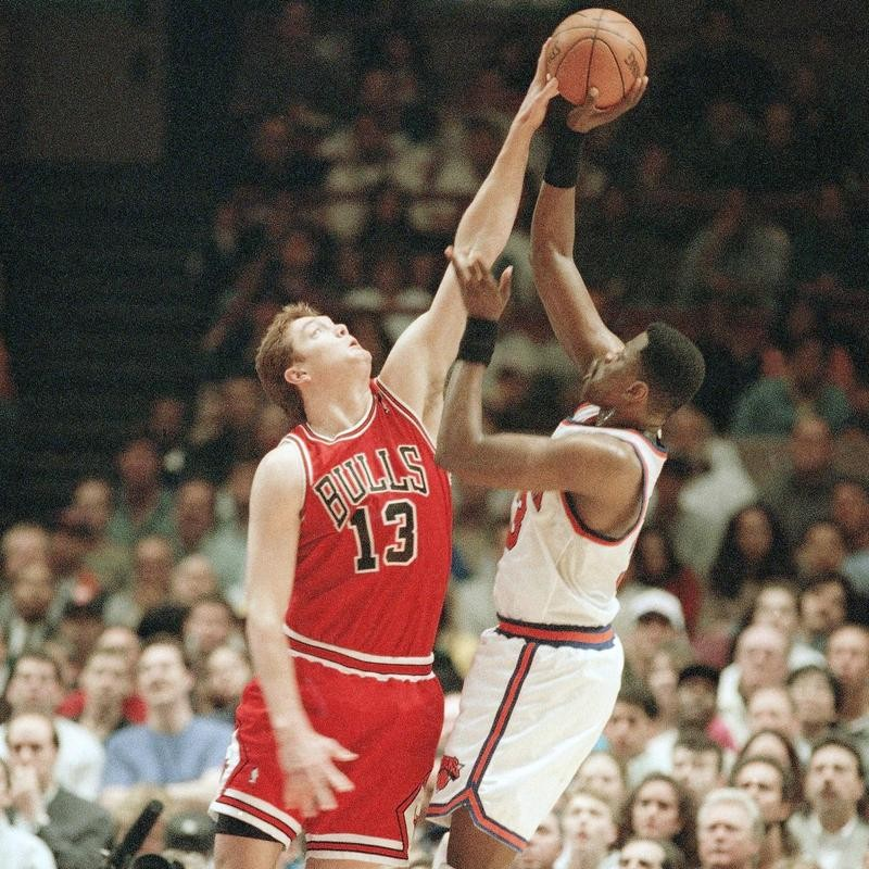 Luc Longley blocks New York Knicks center Patrick Ewing's shot