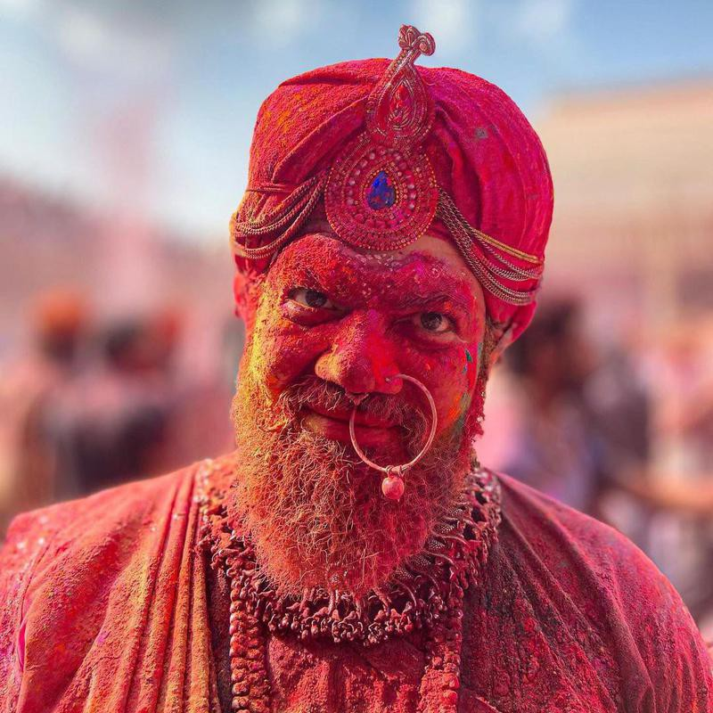 Man covered in colors during Holi
