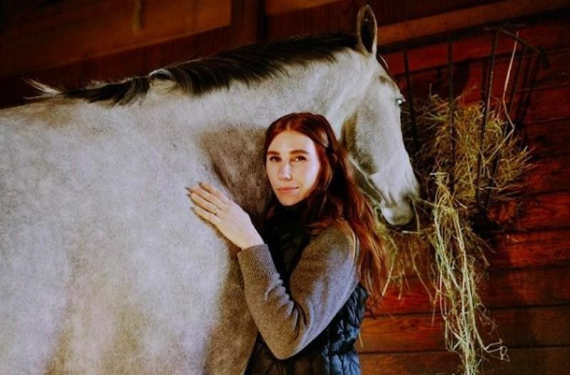 Zosia Mamet poses with horse