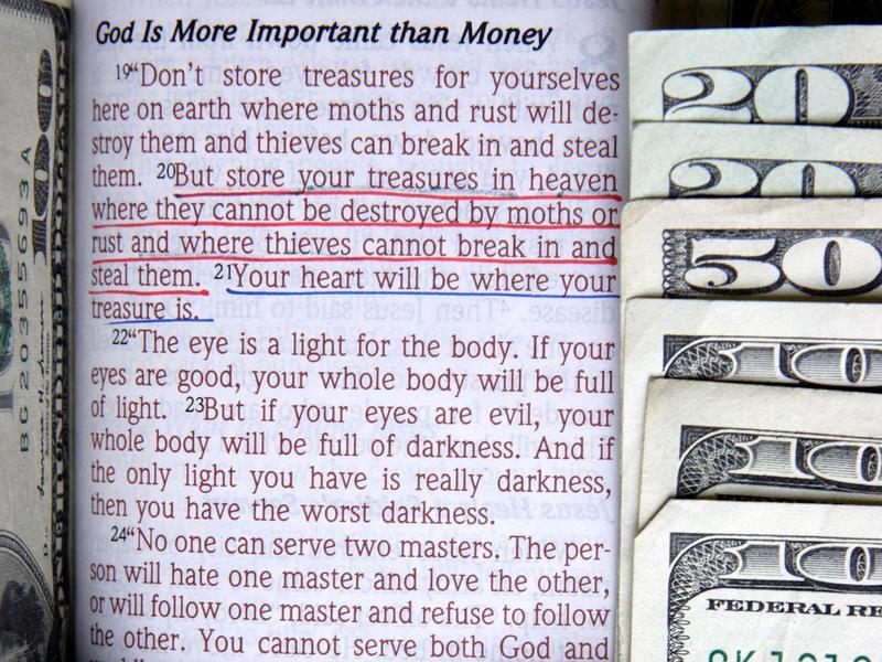Verse with money around it
