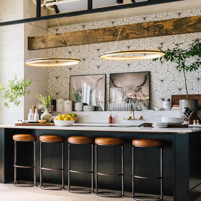 Kitchen with large hanging circle lamps