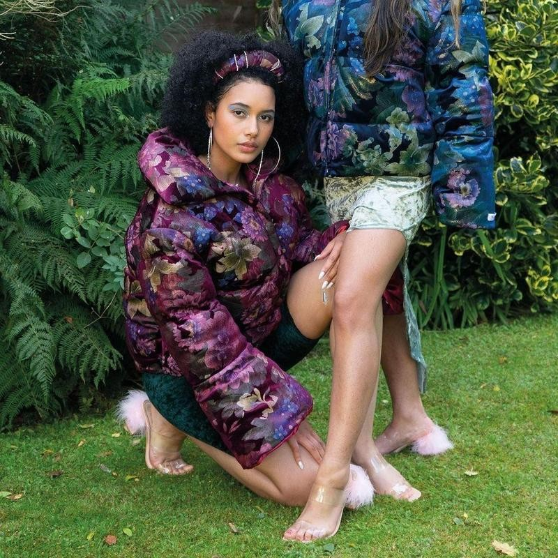 Women in floral jackets on grass