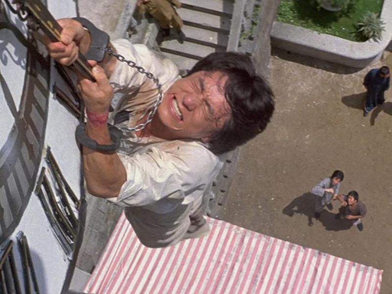 Jackie Chan Hanging From a Clock Face and Letting Go