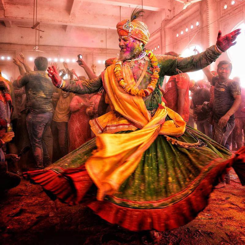 Man dancing in temple during Holi