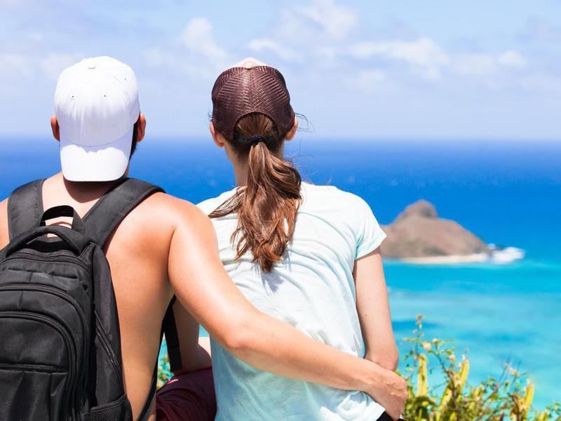 Hikers wearing baseball caps in Hawaii